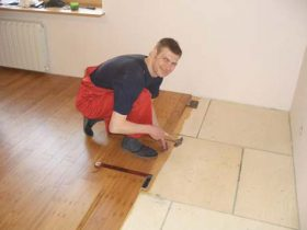 Laying plywood under the laminate