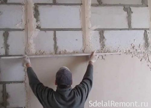 Штукатурка стены без использования маяков
