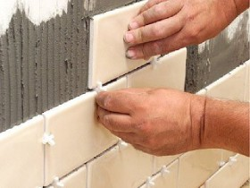 Sticking tiles in the bathroom