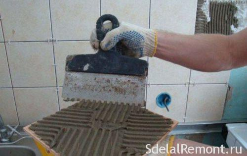 the adhesive is applied on the tiles