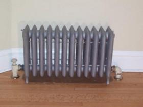 Cast iron radiators on legs